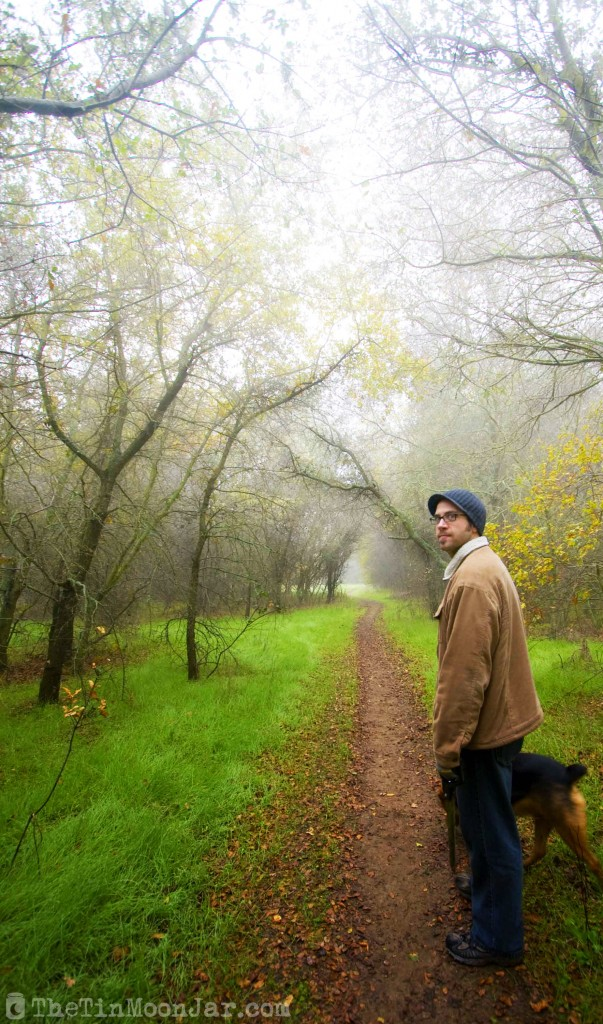 Man, dog, and fog on a spooky trail